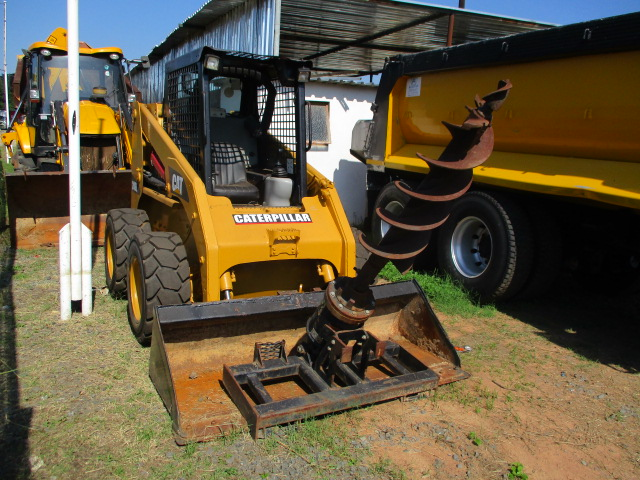2012 CATERPILLER 248E SKIDSTEER WITH DRILL ATTACHMENT Image