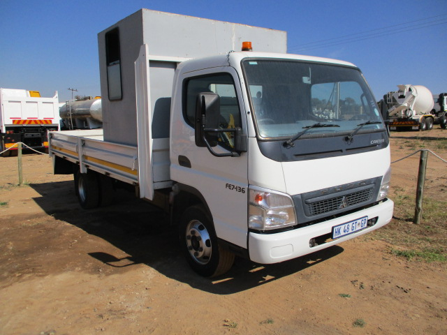 MITSUBISHI FUSO FE7-136 DROPSIDE WITH PERSONEL CARRIER Image