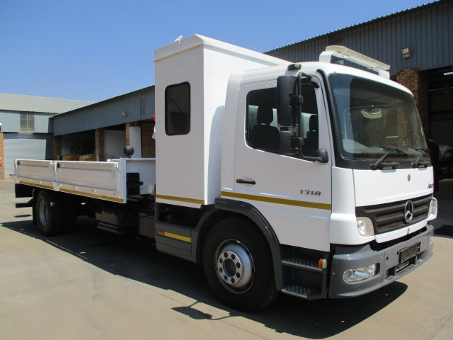 MERCEDES BENZ ATEGO 1318 ROLLBACK WITH CRANE AND PERSONEL CARRIER Image